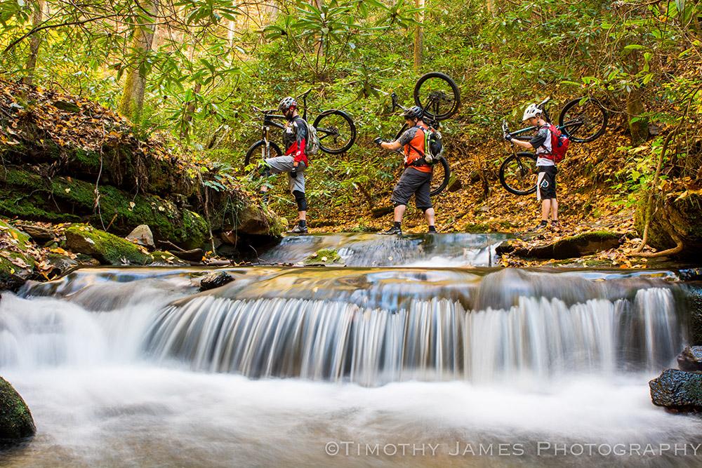 Bikers+Walking+Across+Creek_TJ+Kearns_Internet+Upload